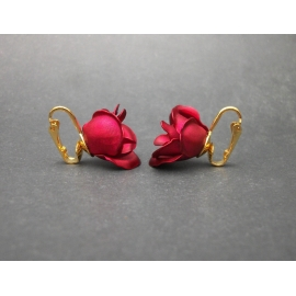 Side view of red rose floral clip on earrings